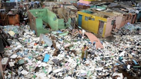 Debris from damaged houses have clogged neighbourhoods | AFP